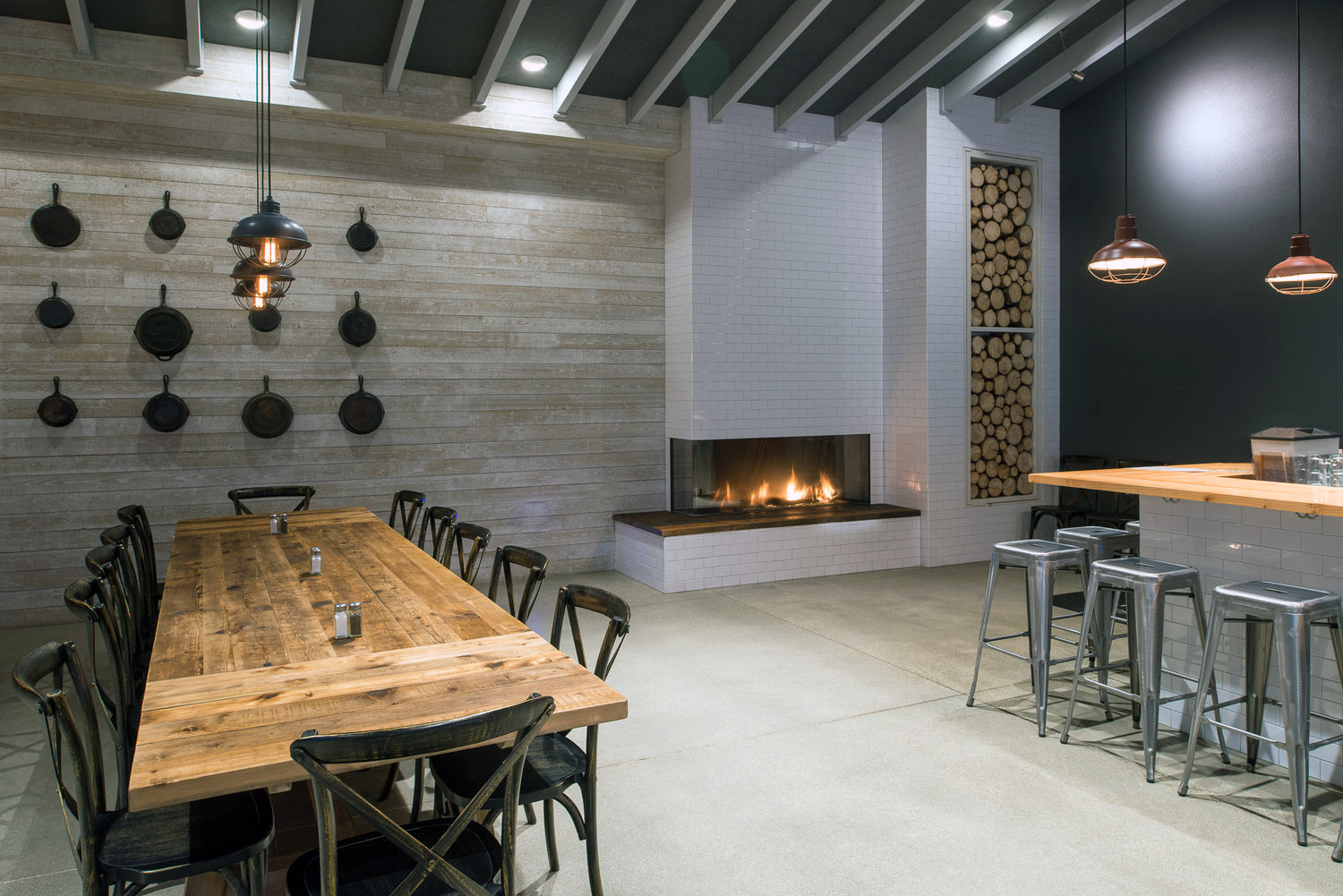 Flexible event space with a fireplace and bar inside Farmhouse Burgers, BBQ & Events located in Sandpoint + Ponderay, Idaho